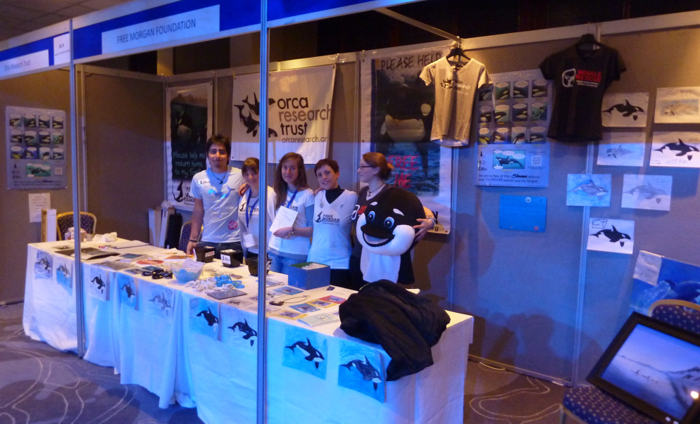 WhaleFest 2014, FMF booth with volunteers - note the children's pictures along the font of the tables & on the walls.
